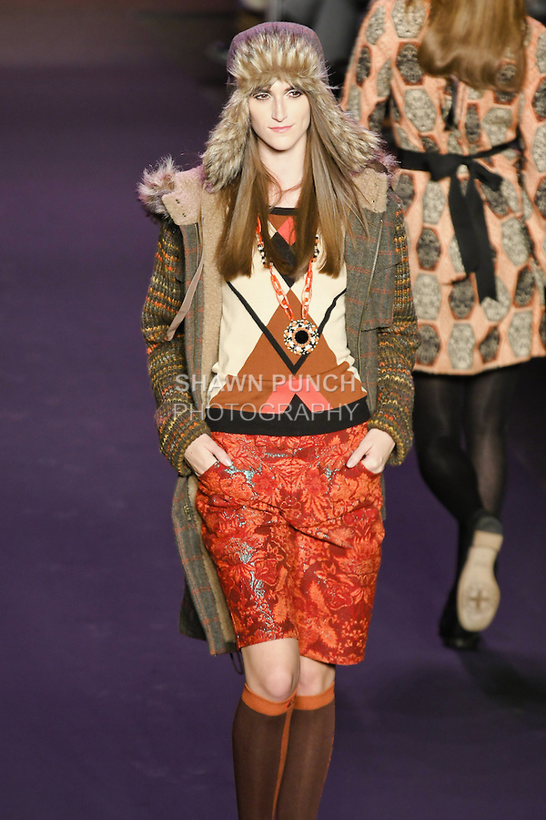 Daiane Conterato walks runway in an outfit from the Anna Sui Fall 2011 collection, during Mercedes-Benz Fashion Week Fall 2011.