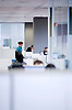Digital. Barcelona 04/12/08 - .Employees working at white office - (c) Vicens Gimenez