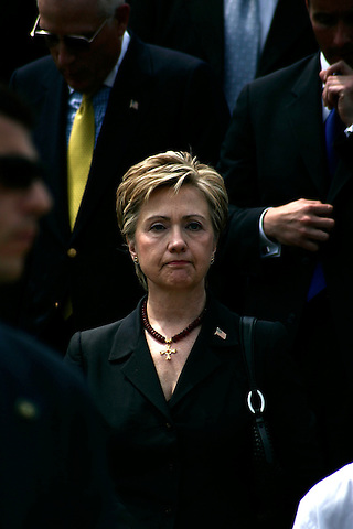 Thousands of police officers and military turned out for the funeral of James McNaughton, the first NYPD officer killed in the war in Iraq. Senator Hillary Rodham Clinton exits the church after the funeral service.