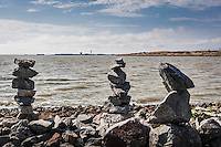 Three exemplars of the rock balancing creations at the San Leandro Marina, across from the Oakland International Airport on San Francisco Bay.