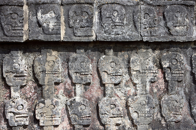 The Tzompantli Temple or Platform of the Skulls, 1100-1300 AD, Toltec Architecture, Chichen Itza, Yucatan, Mexico. Used to display the skulls of enemy warriors defeated in battle as well as the heads of sacrificial victims. Picture by Manuel Cohen
