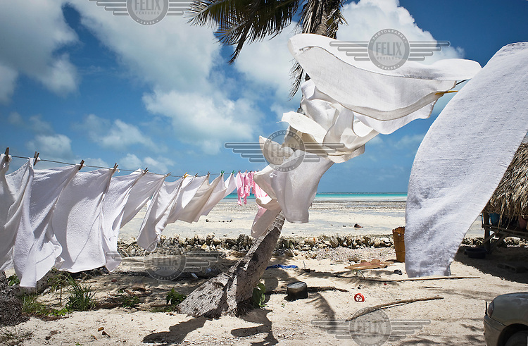 Clothes hang out to dry in the sea breeze.