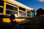 Cleanup workers get on a transportation bus in Grand Isle, LA on June 24, 2010 where oil has reached land.
