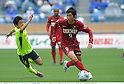 (R-L) Yuya Osako (Antlers), Shohei Ogura (Marinos), APRIL 25th, 2011 - Football : 2011 J.League Division 1 match between Kashima Antlers 0-3 Yokohama Marinos at National Stadium in Tokyo, Japan. The J.League resumed on Saturday 23rd April after a six week enforced break following the March 11th Tohoku Earthquake and Tsunami. All games kicked off in the daytime in order to save electricity and title favourites Kashima Antlers are still unable to use their home stadium which was damaged by the quake. Velgata Sendai, from Miyagi, which was hard hit by the tsunami came from behind for an emotional 2-1 victory away to Kawasaki. (Photo by Takamoto Tokuhara/AFLO).