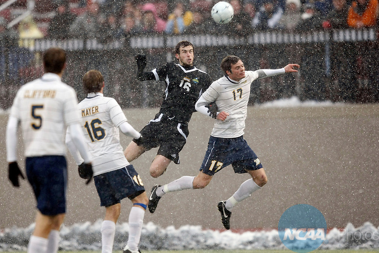 04 DEC 2010:  Adam New (17) of Rollins College and Paul Andrews (16) of Northern Kentucky University jump for a header during the Division II Men's Soccer Championship held at Owsley B. Frazier Stadium on the Bellarmine University campus in Louisville, KY.  Northern Kentucky defeated Rollins 3-2 for the national title.  Jamie Schwaberow/NCAA Photos