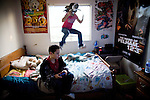 Isaiah Sawyer plays video games while his sister Frances plays January 27, 2010 in Sacramento, Calif. The Sawyer family receives $540/month in CalWORKs assistance from the state of California. Dennis is currently unable to work while recovering from cancer, and Sophia hasn't been able to find work. Gov. Arnold Schwarzenegger has proposed eliminating the CalWORKs program in an effort to balance the state's budget. CREDIT: Max Whittaker for The Wall Street Journal.CABUDGET