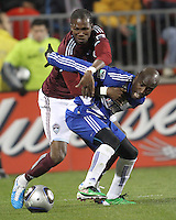 Jair Benitez#5 of FC Dallas holds up Macouma Kandji#10 of the Colorado Rapids during MLS Cup 2010 at BMO Stadium in Toronto, Ontario on November 21 2010. Colorado won 2-1 in overtime.
