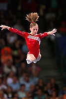 September 2, 2007; Stuttgart, Germany;  Shawn Johnson of USA performs split leap on balance beam during team qualifications in women's artistic gymnastics at 2007 World Championships. Johnson went on to win the women's All-Around gold medal. Photo by Copyright 2007 by Tom Theobald.