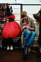A model sits backstage during the fall 2009 Arutyunov Sa catwalk show during London Fashion Week, Friday, Feb. 20, 2009 in London. (Tina Gao/pressphotointl.com)