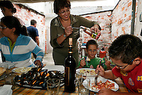 Typical family meal in Burela.  This is the Novoa Villarejo family..Grandmother is Josefa Villarejo.Mother is Maria Jose Novoa.Twins are David Garcia Novoa and Daniel Garcia Novoa..Maria Jose has one girl named Maria and the two twins... Maria has black hair, 16 year old, basketball player..The other family is Maria Jose elder brother: Daniel Novoa Villarejo and his wife is Ines and they have two daughters... One is thirteen years old today (Marta) and she is shown blowing out the candles on the birthday cake.  And the other daughter is 22 years old (Christina) and she is wearing a pink sweatshirt in many of the photos..Contact Info:.Maria Jose Novoa Villarejo.Avda. Da Marina, 41 Portal B, Sixth Floor A.Burela .27880 Lugo.645898322..Birthday Girl Family and Contact is:.Parents are Daniel Novoa Villarejo and Ines Fraga.13 year old is Marta Novoa Fraga.c/ Nosa Senora do Carme, 70 4th floor A.Burela .27880 Lugo