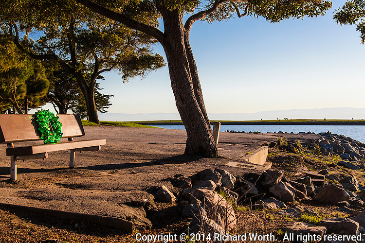 A festive green wreath has been attached to a park bench overlooking San Francisco Bay at San Leandro's Marina Park.