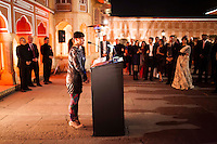 Kathryn Deyell from DFAT invites the next person to the podium to give a speech at the OzFest Gala Dinner in the Jaipur City Palace, in Rajasthan, India on 10 January 2013. Photo by Suzanne Lee