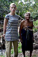 Scarlett stands with 79 yr old Sophinona Thilakawathie a Tsunami affected south Sri Lankan. Sophinona spends her day beating coconut husks to make coir, a fibre that has many uses.