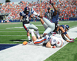Ole Miss linebacker Denzel Nkemdiche (4), Ole Miss defensive back Charles Sawyer (3), and Ole Miss defensive back Cody Prewitt (25) tackle Auburn fullback Jay Prosch (35) at the 1 yard line at Vaught-Hemingway Stadium in Oxford, Miss. on Saturday, October 13, 2012. (AP Photo/Oxford Eagle, Bruce Newman)..