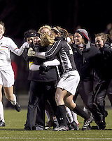 """Boston College defender Hannah Cerrone (11) celebrates her goal with teammates. In overtime, Boston College defeated University of Washington, 1-0, in NCAA tournament """"Elite 8"""" match at Newton Soccer Field, Newton, MA, on November 27, 2010."""