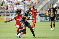 Danny Mwanga (10) of the Philadelphia Union is marked by Julian de Guzman (6) of Toronto FC. The Philadelphia Union defeated Toronto FC 2-1 on a second half stoppage time goal during a Major League Soccer (MLS) match at PPL Park in Chester, PA, on July 17, 2010.