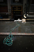 New York, New York.October 30, 2012..A small pump churns out water from a shop near Wall Street and the financial district as a result of Hurricane Sandy.