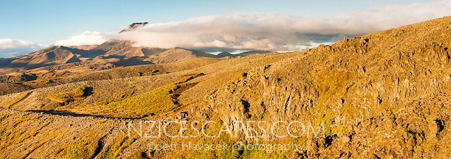 Sunset over fields of volcanic rock and Mount Ngaruhoe in background, Tongariro National Park, Central Plateau, North Island, UNESCO World Heritage Area, New Zealand, NZ