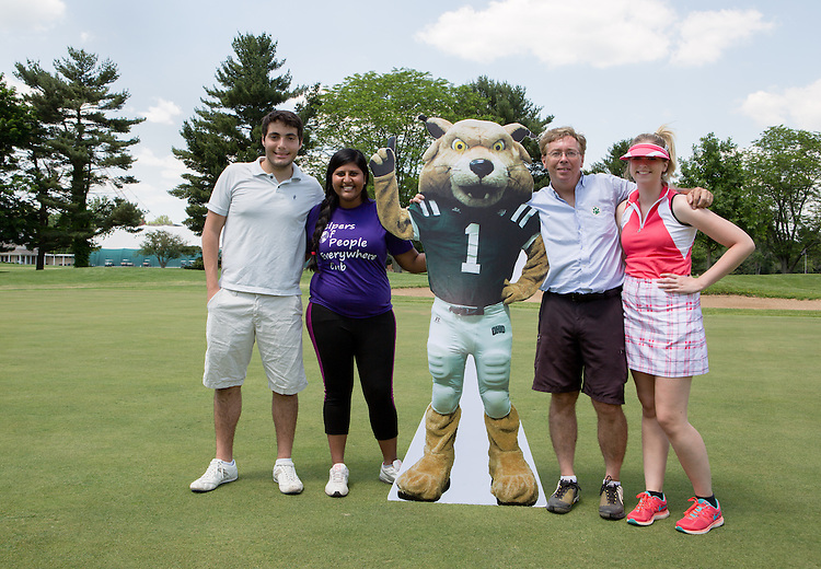 Left to right: Iago Rogue, Ann Jacob, Craig Brown, and Saira Brown at the Alumni golf outing. Photo by Lauren Pond