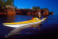A sea kayaker explores the sea caves near the Devils Island lighthouse on Devils Island in the Apostle Islands National Lakeshore near Bayfield, Wis.