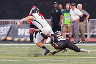 Baltimore, MD - SEPT 10, 2016: St. Francis (Pa) Red Flash quarterback Zack Drayer (7) avoids a sack by Towson Tigers linebacker Chris Tedder (38) during their match up at Johnny Unitas Stadium in Baltimore, MD. The Tigers defeated St. Francis 35-28. (Photo by Phil Peters/Media Images International)