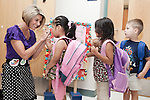 September 14, 2011. Raleigh, NC. . Kim Jackson, the head teacher for the class, greets students at the door at the 8:30 am arrival time.. Project Enlightenment, a public pre-kindergarten program for at risk children, has been threatened with closure due to state wide budget cuts..