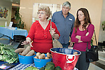 November 23, 2010. Chapel Hill, NC.. MaryJane Gordon, left, her daughter Chris King, discuss sweet potato varieties with Stanley Hughes and his wife linda Leach, at the UNC Hospital Farmer's Market..   The sweet potato seems to be having a comeback, with many farmers increasing their planting of the potato's numerous varieties, as well as many restaurants including it on their menu in various forms such as the ever popular sweet potato fry.