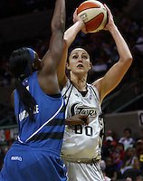 San Antonio's Ruth Riley (00) takes aim at the basket while Washington's Crystal Langhorne (1) tries to block during the WNBA game between the San Antonio Silver Stars and the Washington Mystics, June 6, 2008, at the AT&T Center, San Antonio, Texas. (Darren Abate/PressPhotoIntl.com)