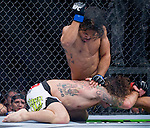 Benson Henderson brings an elbow down on Clay Guida during Saturday's UFC on Fox event at the Honda Center.