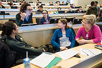 From left, Brenton Nash, Sonam Kapadia, Jeanne Gosselin, Jennifer Hanson. Class of 2016 students work through a team-based learning exercise. This is a way to ?flip? the classroom.  In team-based learning, students perform an assignment in advance of the session, then meet in a large group session to work through summative examinations individually and in groups.