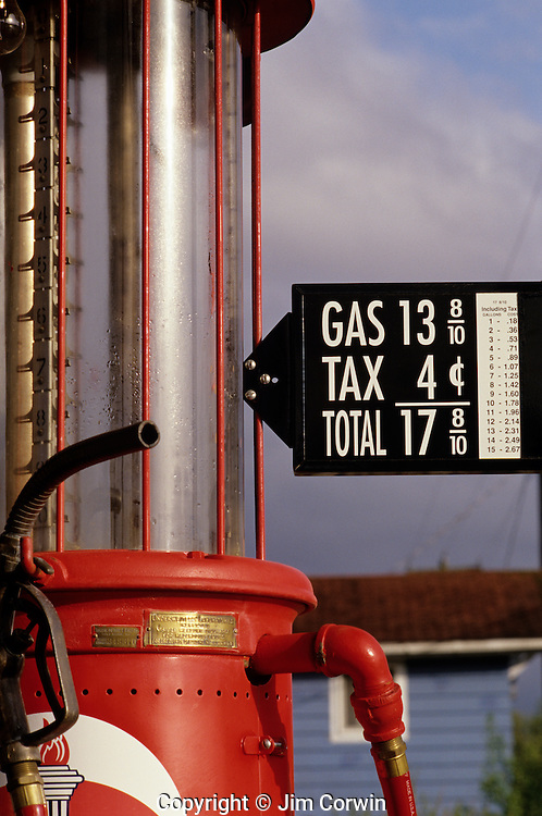 Historic gas station close up of old gas pump with cheap gas price signs displayed at sunset Galvin Washington State USA