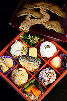 "The origin of bento can be traced back to the Kamakura Period when cooked and dried rice called hoshi-ii literally ""dried meal"" was developed. In the Edo Period bento culture spread and became more refined. Bento became even more popular in the 80s with the help of the microwave and the proliferation of convenience stores. The expensive wood and metal boxes have been replaced at most bento shops with inexpensive, disposable plastic ones Even handmade bento have made a comeback, and they are once again a common sight at picnics."