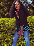 Laughing young african american woman in colorful clothes in a park