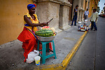 A fruit vendor on the street in Cartagena, Colombia. ..Photo by Robert Caplin