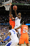 31 MAR 2012: Forward Michael Kidd-Gilchrist (14) from the University of Kentucky puts up a shot in front of center Gorgui Dieng (10) from the University of Louisville during the Semifinal Game of the 2012 NCAA Men's Division I Basketball Championship Final Four held at the Mercedes-Benz Superdome hosted by Tulane University in New Orleans, LA. Ryan McKeee/ NCAA Photos.