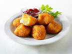 Deep fried Camembert in bread crumbs with cranberry sauce