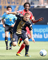 Jordan Harvey #2 of the Philadelphia Union gets the ball away from Fuad Ibrahim #7 of Toronto FC during an MLS match at PPL stadium in Chester, PA. on July 17 2010. Union won 2-1 with a last minute penalty kick goal.