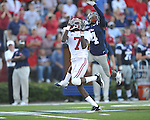 Ole Miss' Marcus Temple(4) bats a pass away from Alabama wide receiver Marquis Maze (4) at Vaught-Hemingway Stadium in Oxford, Miss. on Saturday, October 14, 2011. Alabama won 52-7.