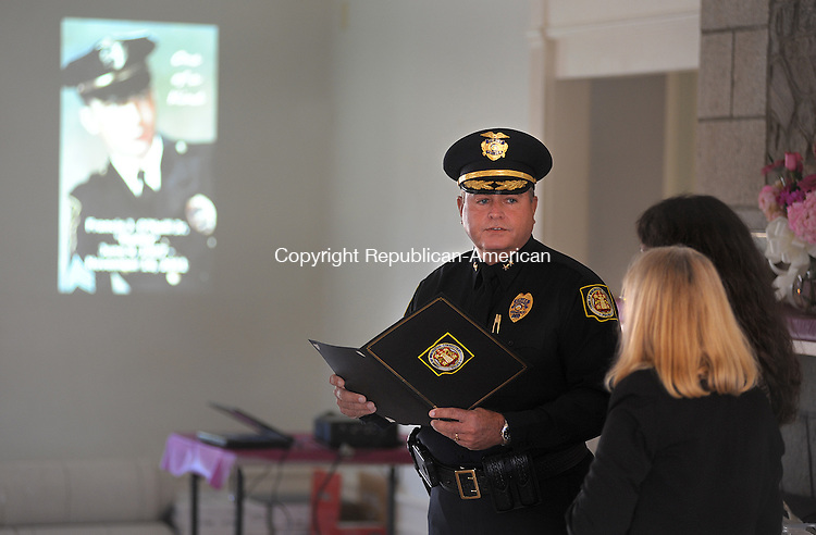 "WINSTED  CT, 19 FEBRUARY  2012-021912JS05-Winsted Police Chief Robert M. Scannell presents a proclamation to Barbara O'Neill, the wife of the late Captain Francis J. ""Buddy"" O'Neill, Jr., and his daughter Deb O'Neill of Helena, Montana during a memorial service Sunday at the Knights of Columbus hall in Winsted. Francis O'Neill, Jr., who was a member of the Winsted Police Department for 28 years, died November 16, 2011. .Jim Shannon Republican-American"