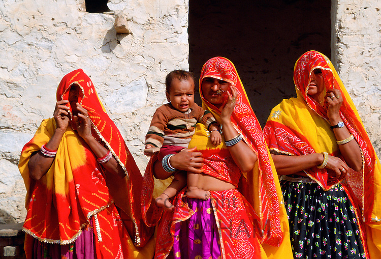 Veiled women with a child at Nalu Village, Rajasthan, India