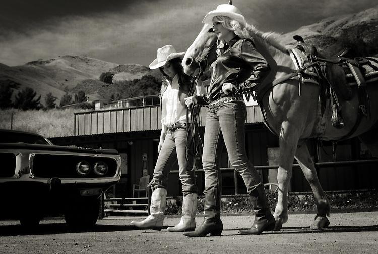 Two female models walking a horse