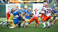 SAN FRANCISCO, CA - December 31, 2011: UCLA linebacker Todd Golper (55) attempts to recover a fumble during the against University of Illinois during the Kraft Bowl at AT&T Park in San Francisco, California. Final score Illinois wins 20-14.