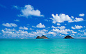 Water, sky, clouds and Mokulua Islands from Lanikai Beach, Kailua; Windward Oahu, Hawaii.