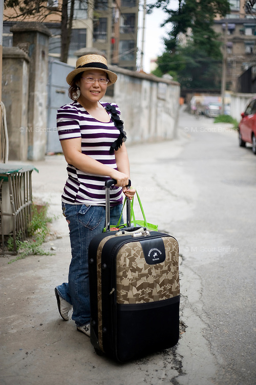 Shikan, a student, age 22, poses for a portrait in Nanjing. Response to 'What does China mean to you?': 'My home, my love.'  Response to 'What is your role in China's future?': 'I hope to make a contribution to China's environment.'