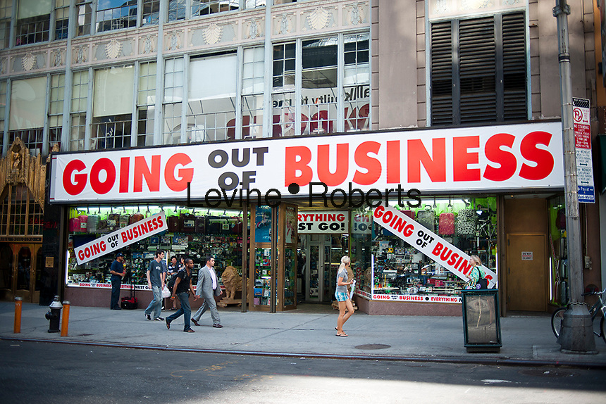 A store on Broadway in Times Square in New York on Wednesday, June 29, 2011 dramatically announces that it is soon going out of business. (© Richard B. Levine)