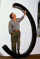 Canal St, New York City, New York - April 14th,1986. Photograph taken of Bernar Venet standing infront of his sculpture at his New York studio. Bernar Venet (born 21 April 1941) is a French conceptual artist who has exhibited his works in various locations around the world, and is particularly renown for his metal Arcs.