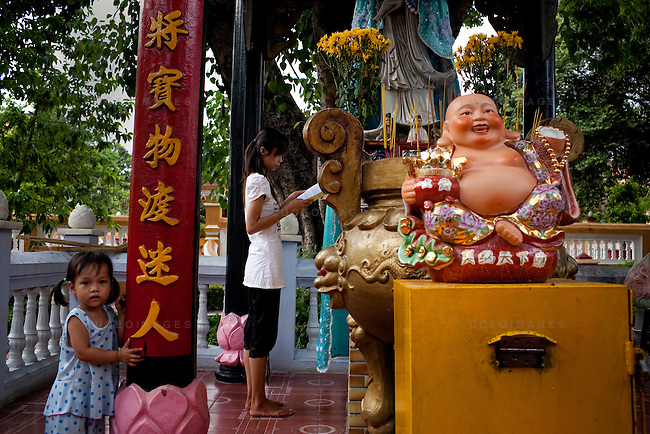 A woman prays at the Giac Lam Pagoda in Tan Binh District in Ho Chi Minh City, Vietnam. Photo taken Tuesday, May 4, 2010....Kevin German / LUCEO