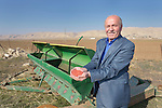 Isaac Oraha, a farmer displaced by the Islamic State group in 2014, displays wheat seeds he is planting in a field outside Alqosh, Iraq. Oraha received the machinery and necessary training in a livelihood program sponsored by the Christian Aid Program Nohadra - Iraq (CAPNI).
