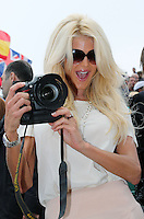 Victoria Silvstedt plays with a photographer's camera at the Monte-Carlo Rolex Masters