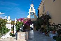 Paleokastritsa Monastery, 13th Century with belltower portico and bougainvillea in courtyard in Corfu, , Greece